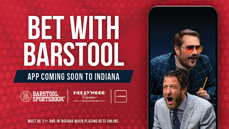 "smartphone with image of Dave Portnoy & Big Cat, text: ""Bet with Barstool / App Coming Soon to Indiana / Barstool Sportsbook logo, Hollywood Casino Indiana logo, mychoice logo / Must be 21+ and in Indiana, when placing bets online."""