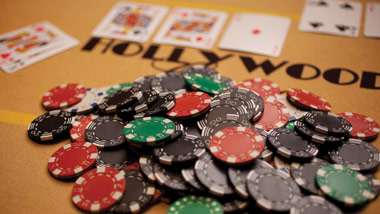 poker chips and cards on a Hollywood Casino table