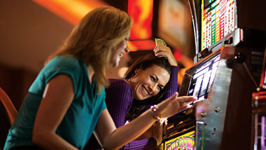 2 women playing the slots