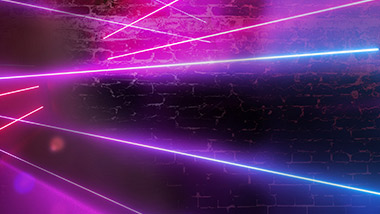 Neon beams of light on a brick background